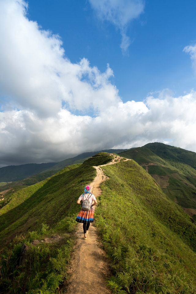person-walking-on-the-mountain-path